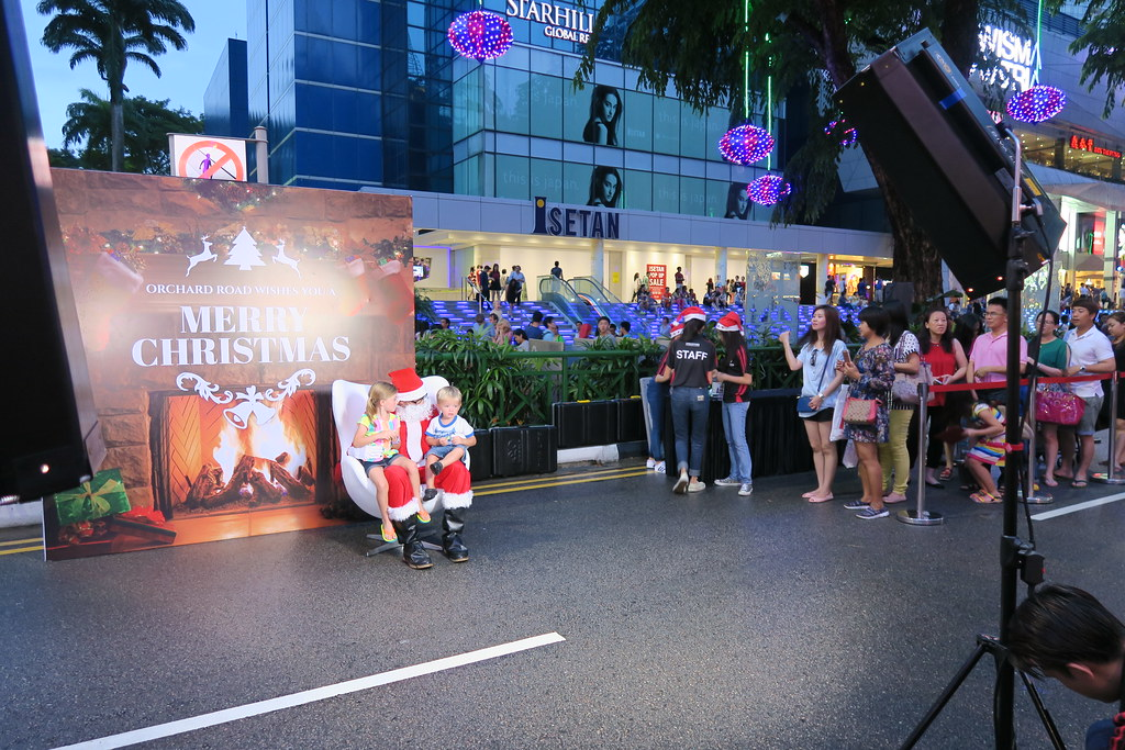 Instant photo taking with Santa Clause at Pedestrian Night