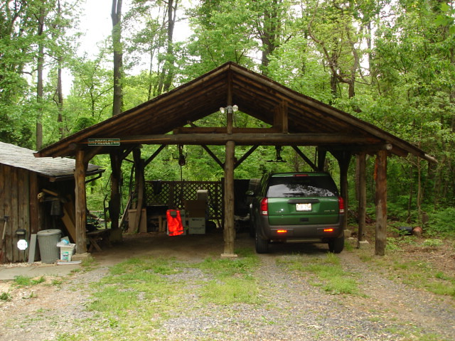 Log Carport Carport Made Of Logs Protecting A Saturn Vue