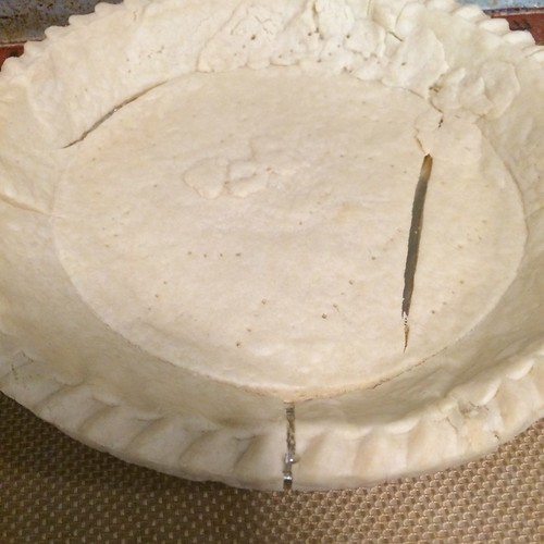 A baked pie crust containing three large cracks; not suitable for quiche.
