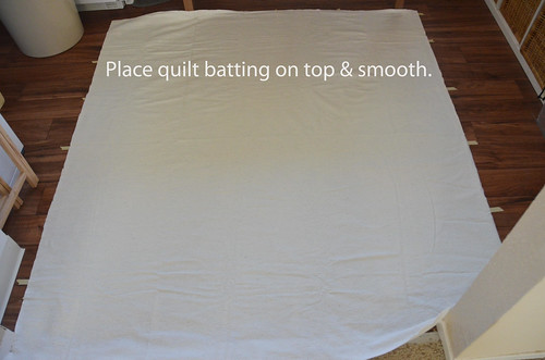 2. Place quilt batting on top of quilt backing.
