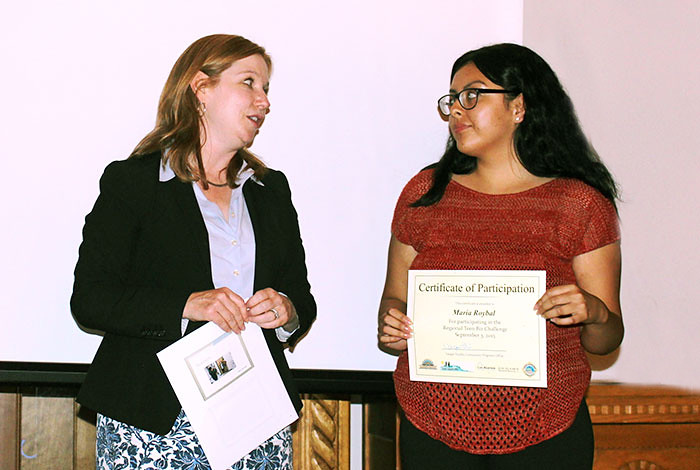 Kathy Keith, Los Alamos National Laboratory's Community Programs Director, congratulates Maria Roybal of the Teen Biz Challenge's Ready, Set, Snap team (l to r).