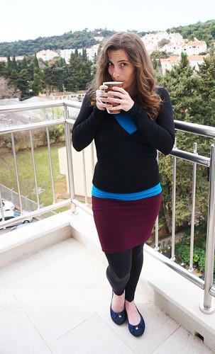 Gigi in black sweater purple skirt