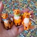 3 tiny foxes