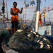 A fisherman prepares his fishing nets in Jamestown Fishing Village in Accra, Ghana