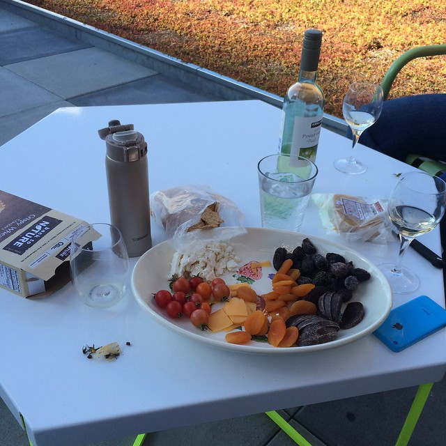 Half eaten platter of cheese, fruit, tomatoes, and chocolate. Someone else also brought cheese. And she brought a really crisp bottle of Pinot Grigio.