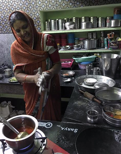 Durga Sharma making a delicious bread out of millet.