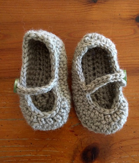 Crocheted green baby booties.