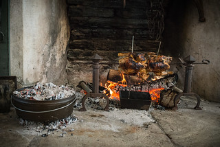 Pie in Dutch Oven and Chickens Roasting on Spit by the Fire | by goingslowly