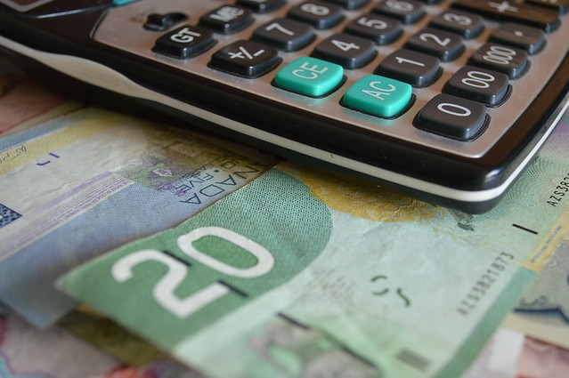 Photo of money and a calculator