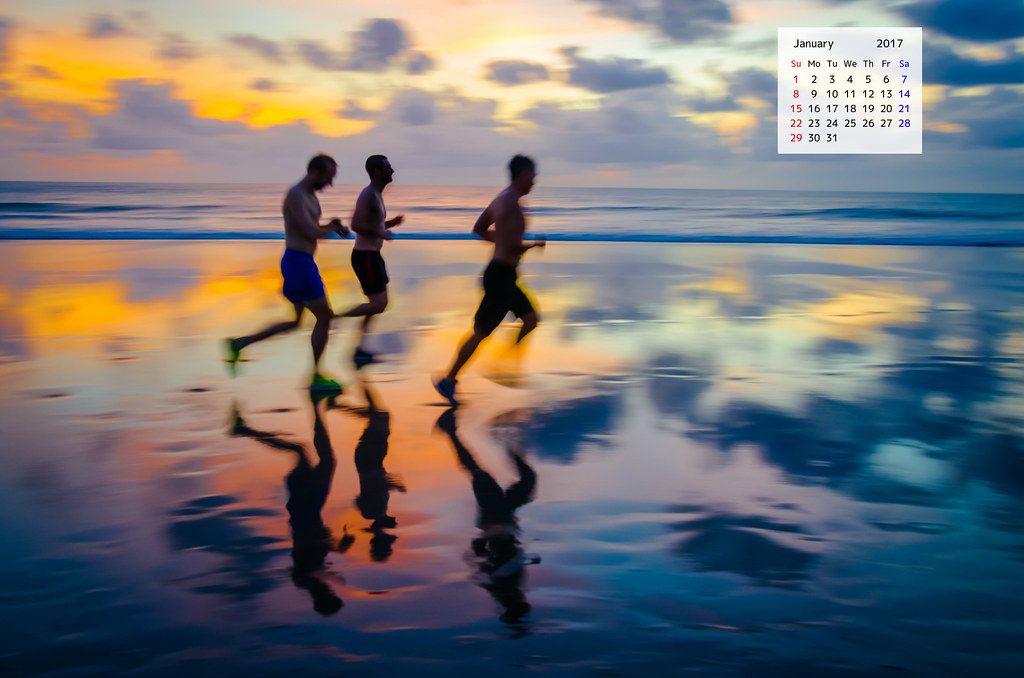 Download January 2017 Desktop Calendar featuring runners on a Bali Beach