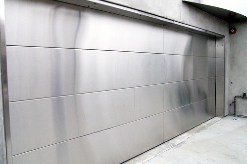 Stainless steel garage door this door has to cost a for Garage door refacing