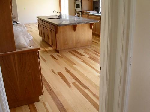 Hickory hardwood floor glued to concrete slab owens