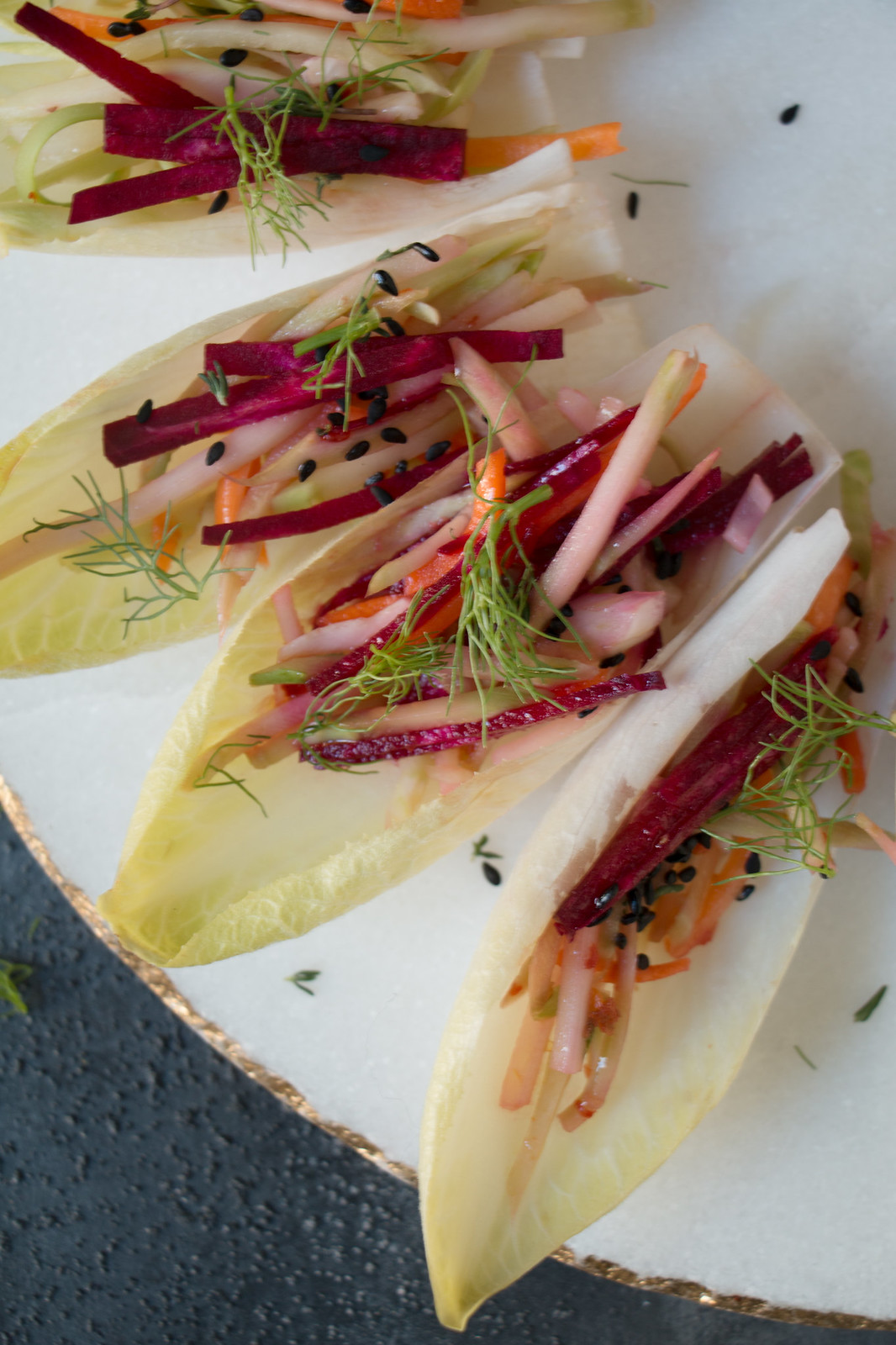 Endive Boats with Beet-Carrot-Fennel-Pear in Asian dressing