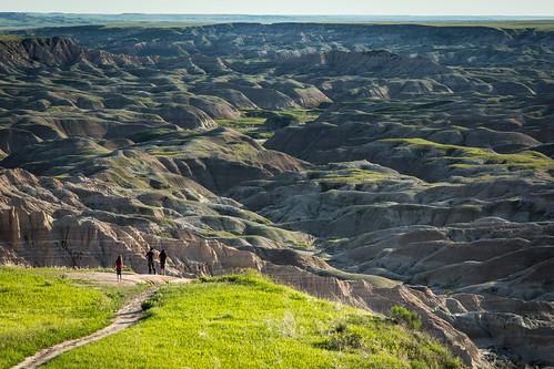Oglala Lakota children standing at the Red Shirt Table overlook surveying Badlands National Park