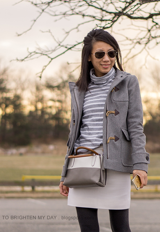 gray duffle coat with toggles, gray striped oversized turtleneck, colorblocked crossbody bag, white wool mini skirt, dark gray tights