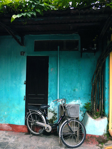 A turquoise wall with a bike in Hoi An, Vietnam