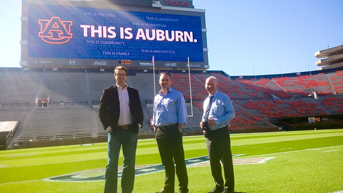 Pictured, from left inside Jordan-Hare Stadium, are Auburn Professor Scott McElroy, STRI Group Director Lee Penrose and STRI Group CEO Mark Godfrey. (Flickr.com)