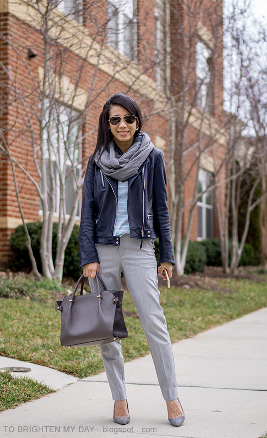 herringbone and plaid infinity scarf, black leather jacket, light blue striped top, gray pants, gray suede pumps