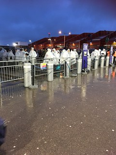 It looks as if we were dressed in decontamination suits, but these were ponchos we were given as we waited in the rain and cold for a coach from Luton Airport to Heathrow Airport that never turned up. | by indtravhelp