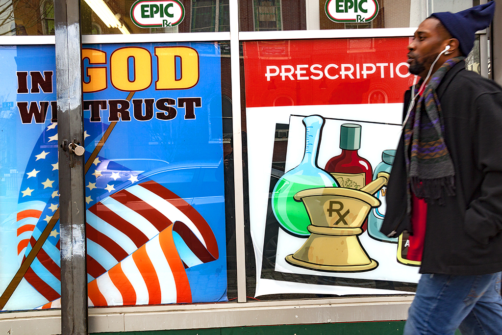 IN GOD WE TRUST sign at drug store on H Street--Washington