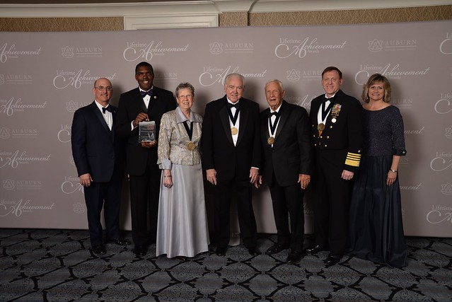 Shown are the four recipients of the Alumni Association's Lifetime Achievement Award and the Young Alumni Achievement Award.