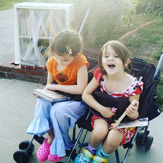 We stopped at the little free library on the walk home to pick up some books. :-) | by Urthmama
