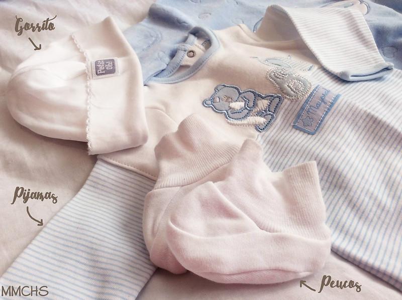 ropa para el bebe en la canastilla