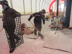 Removing the flooring from inside of the drill tent.