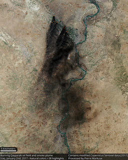 Satellite view of the burning Qayyarah oil fields in Iraq | by Pierre Markuse