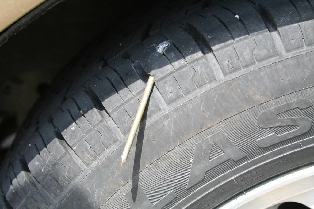 Nail In Tire | Douglas Porter | Flickr