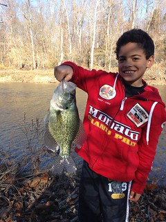 Photo of young angler holding a crappie