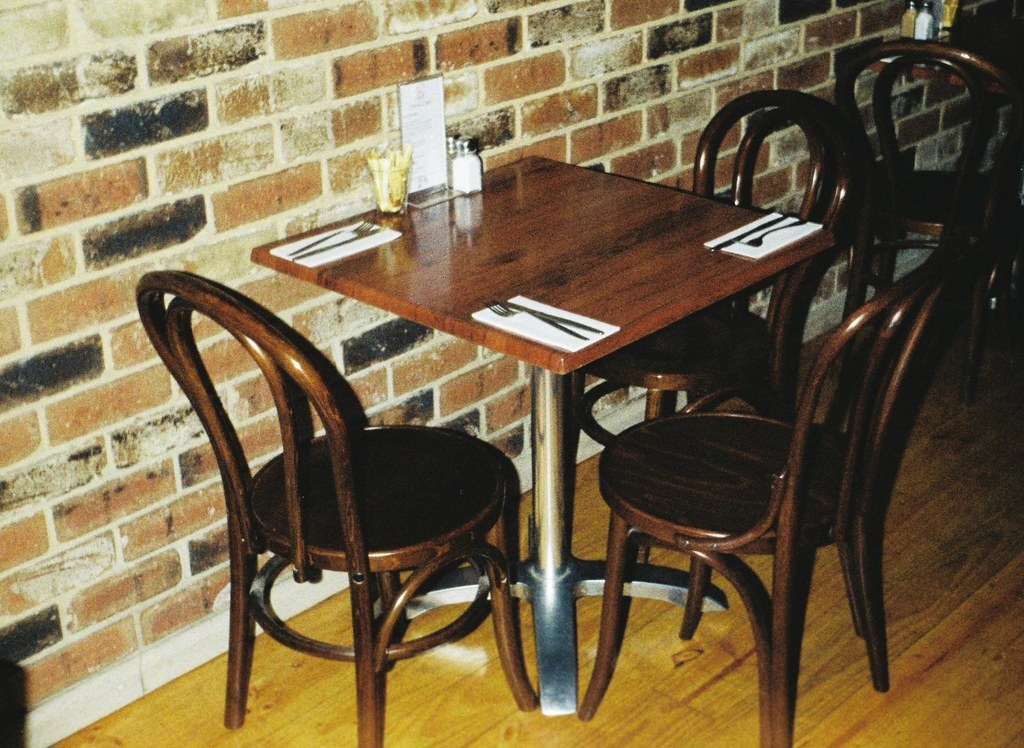 Table and chairs, exposed brick wall | Photographed using th… | Flickr