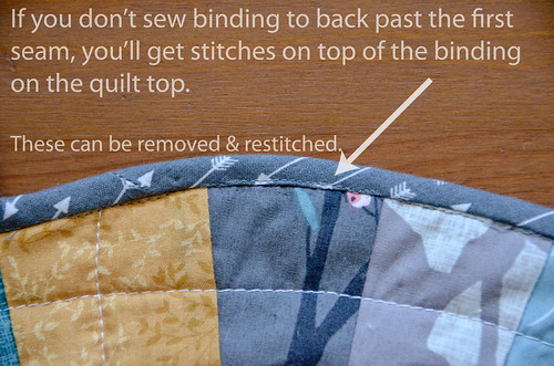 9. If you didn't do Step 6 correctly, you'll have some seams showing on the binding on the top of the quilt. These are pretty simple to rip out and redo, starting/stopping with small stitches to secure thread.  Check for flaws and fix.