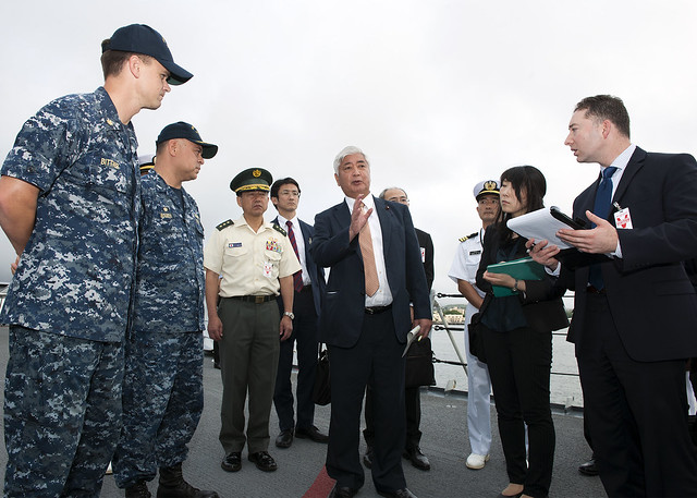 Gen Nakatani, center, the Japanese Minister of Defense, speaks with Capt. Adolfo Ibarra, second from left, commanding officer of the guided-missile cruiser USS Port Royal (CG 73), and staff members of Nakatani's cabinet during a tour of the ship as part of Nakatani's visit to Pearl Harbor.