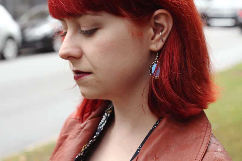 Mirror Earrings and Bright Red Hair