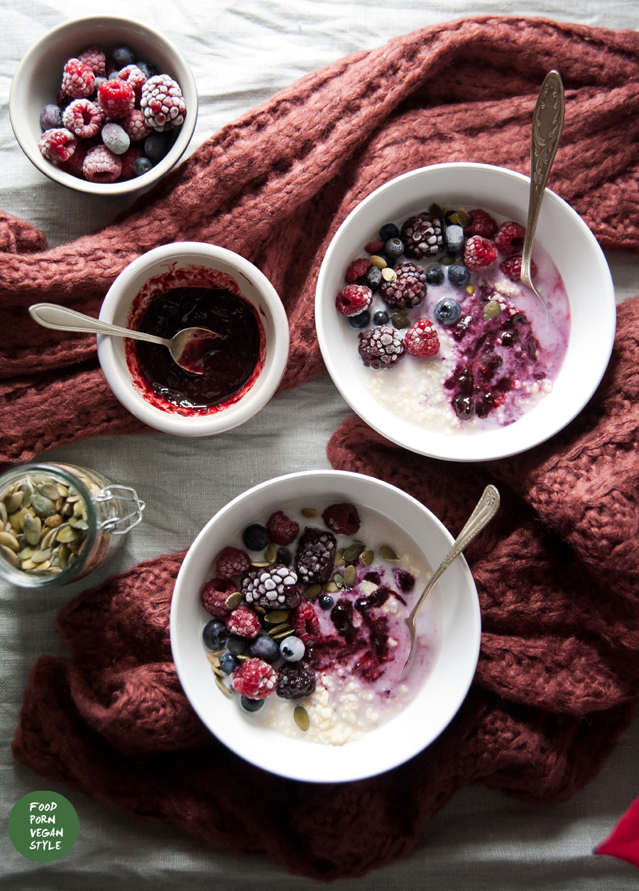 Millet porridge with a homemade blueberry jam, frozen fruits and hazelnut milk