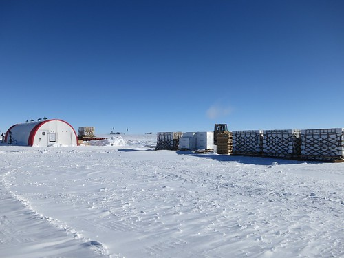 On the left is the drill tent and on the right are several pallets of empty ice core boxes | by U.S. Ice Drilling