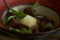 Sweet potato hash, braised goat, cabbage, poached egg, hollandaise