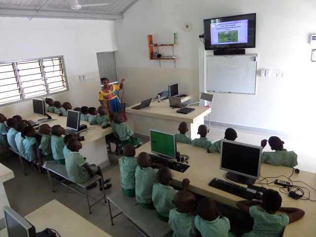 Madam Odelia with her class in the IT Lab