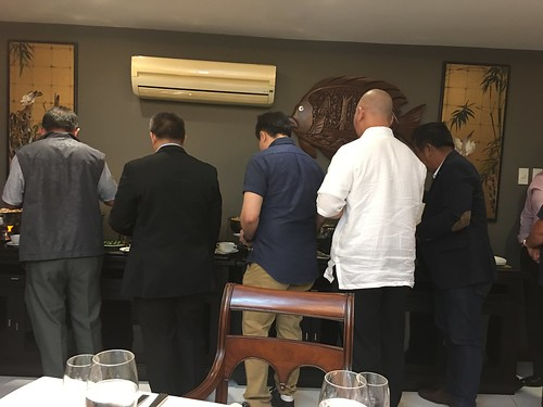 Guys getting food at buffet,  GMA's house