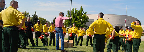 Australia and New Zealand fire managers are provided instruction prior to a practice fire shelter deployment