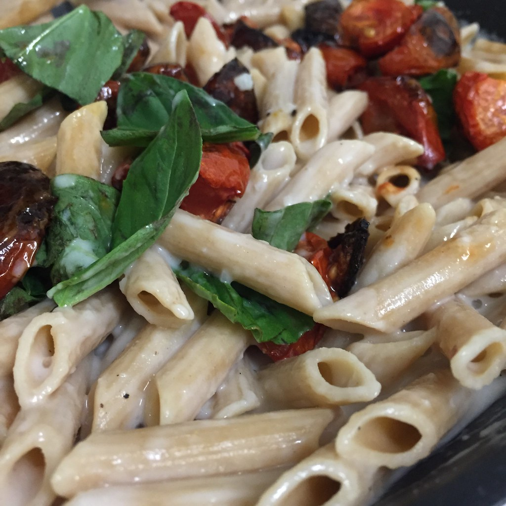 creamy vegan pasta with roasted tomatoes and basil, whipped up in my kitchen on tuesday night