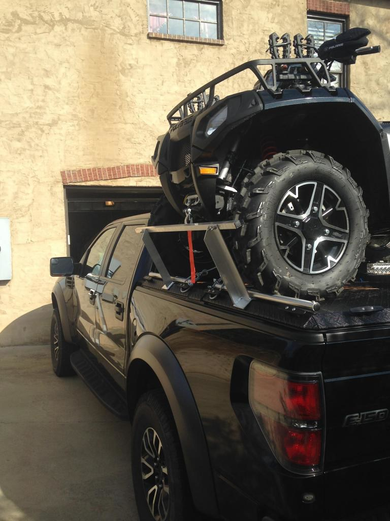 New Ford Truck >> An ATV Loaded On Top Of a Ford F150 Truck Bed. | A ...
