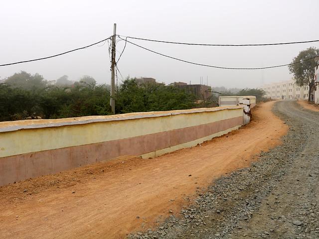 सीता सागर की जमीन पर बनी पक्की सड़क