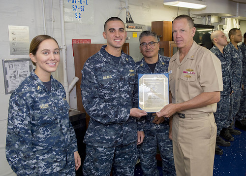 SAN DIEGO – Commander, Naval Supply Systems Command Global Logistics Support, Rear Adm. James R. McNeal awards the USS Makin Island's (LHD 8) Supply Department with the Navy Exchange Command Ship's Store Retail and Services Excellence Award.