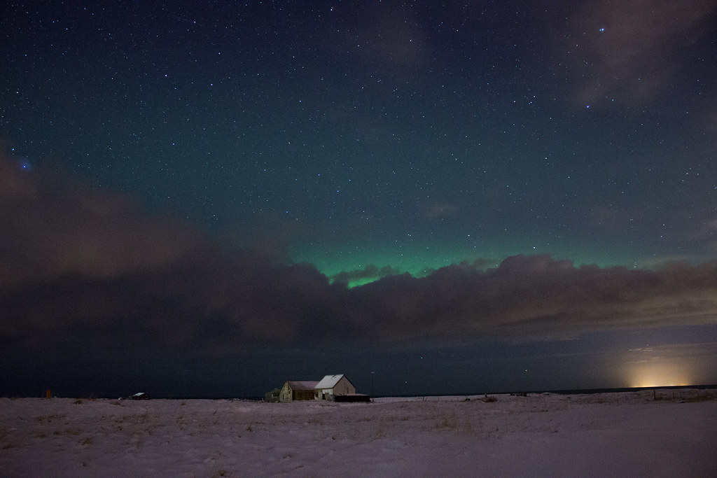 The northern lights behind a cloud in Iceland