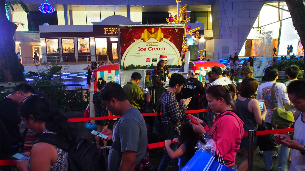 All of these people in the queue are downloading the OneOrchard mobile app to get their free ice cream.