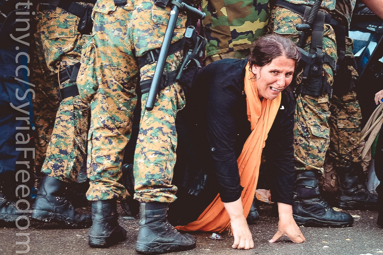 A woman cries as she crawls through a block of border police in the southern Macedonian town of Gevgelija, Sept. 10, 2015. | by FreedomHouse