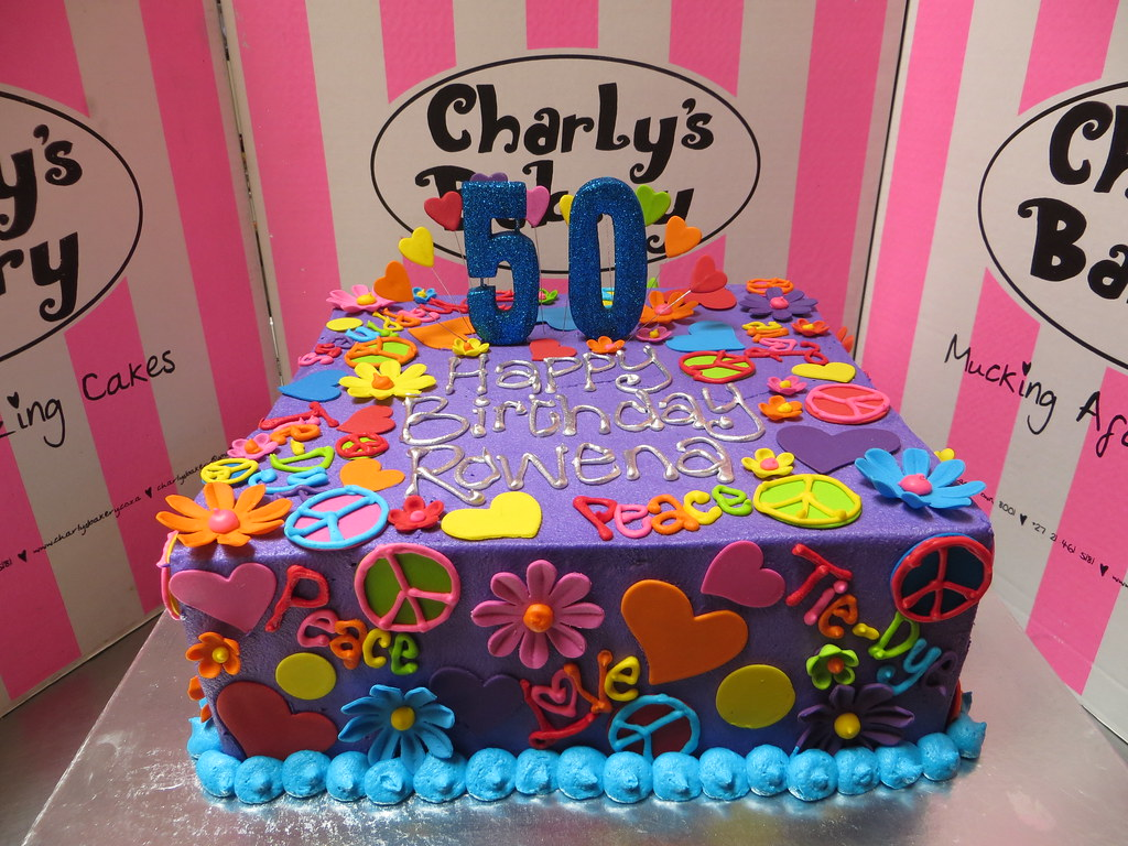 Hippie Themed 50th Birthday Cake Iced In Purple Butter Icing With Piped Words Daisies