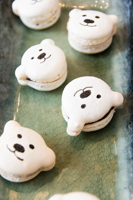 peppermint macarons with a ganache filling in cute polar bear shapes. Recipe on kokocooks.com
